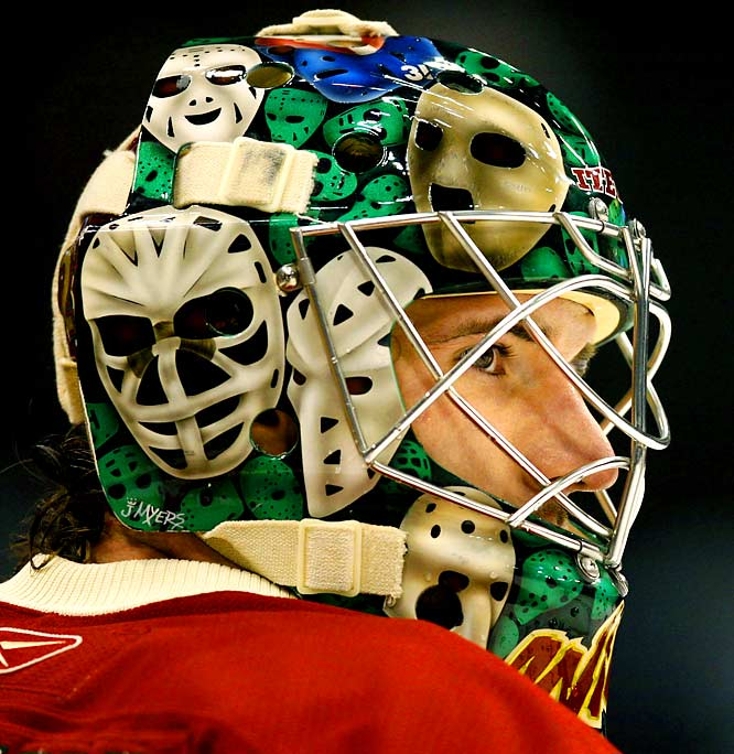 The top goalie mask of the decade is hands down the ultimate goalie tribute mask to date. Massachusetts-based mask artist Mike Myers painted a collage for Harding (first seen in 2006) depicting classic goalie masks worn by hockey's greatest goalies, including Jacques Plante, Ken Dryden, Gerry Cheevers, Tony Esposito, Terry Sawchuk, Pelle Lindbergh and Ed Giacomin.