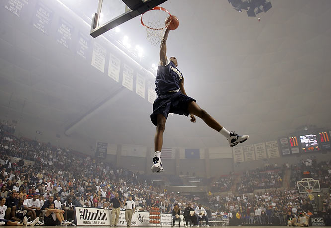 """I took this photo of UConn freshman Rudy Gay's final attempt in the slam dunk contest during 'Midnight Madness' in Storrs. He was the team's top recruit and won over the fans with this dunk called 'The Michael Kick.' They shot off indoor fireworks earlier in the evening, and it gives this image an etheral quality that you normally wouldn't see."""
