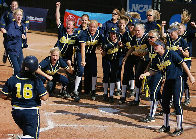 """This was at the end of a NCAA regional softball game in Ann Arbor, Mich. The Michigan player had just hit a walk-off homer, and the rest of the team was there to celebrate. I just like the joyful expressions. It seems the higher you go in sports, the less happiness shows through on a regular basis. These Michigan women were playing for all the right reasons."""