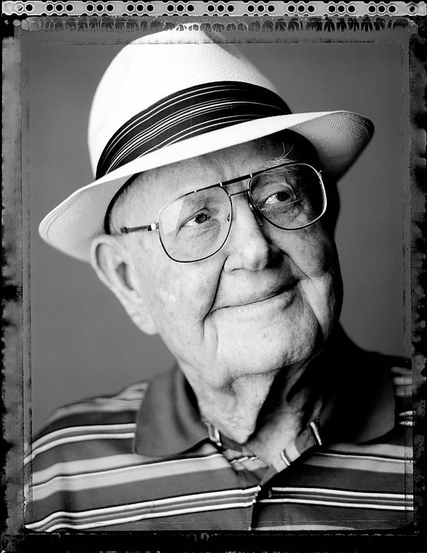 """We shot this as part of a golf portrait package on U.S. Ryder Cup captains. Byron Nelson always epitomized what I felt to be the classic (and classy) sports hero from a long-gone age. This is, as far as I know, the last formal portrait (and very possibly the last set of photographs) ever taken of him; he diedtwo weeks later. I love the subtle expression on his face. For months afterward I kept trying to figure out what had brought on the sideways glance and slight curl of his lips into a barely perceptible smile that set this particular frame apart from the others I shot that day. It was only after my assistant sent me a few snapshots from the shoot that I realized that at an instant before I took the picture, his wife, Peggy, had quietly walked into the room."""
