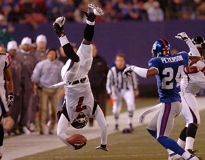"""They say a picture is worth a thousand words as Michael Vick lands on his head here in 2006 against the New York Giants."""