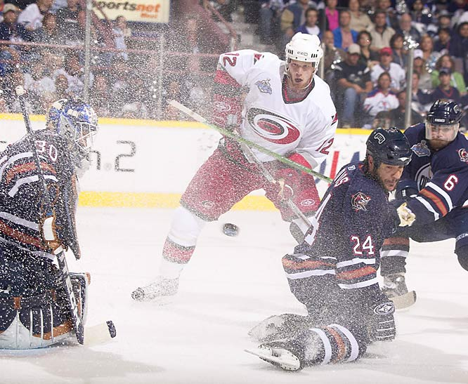 """This was at the Stanley Cup finals in 2006 and there's a lot going on. You don't see many images where the spray of the ice is all over the frame. It's like a curtain of ice hanging in the air, frozen by the strobes, and you're watching the action through it."""