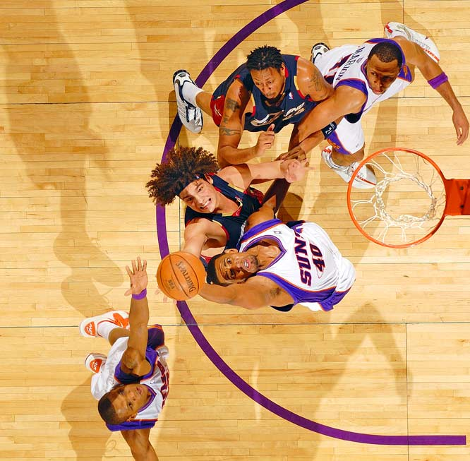 """This shot of the Cavaliers and Suns was taken from the catwalk. In basketball, any battle for the ball presents great faces and compositions. We decided that instead of doing the usual point of focus -- the circle and the basket -- we'd do a longer horizontal view to get the entire lane. It just gives a little different look, a nice look for basketball."""