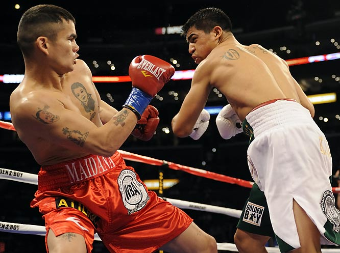 Ortiz, SI.com's 2008 Prospect of the Year, looked to be well on his way to a piece of his first major title when he dropped Maidana early in the opening round. That was until the scrappy Maidana sent him careening to the canvas with a right hand of his own 14 seconds later. The fight, in which Ortiz planned to showcase his boxing skills, quickly turned into an all-out slugfest, setting the tone for Maidana's eventual sixth-round TKO victory. <br><br>Runner-up: Juan Manuel Lopez vs. Roger Mtagwa, Round 11