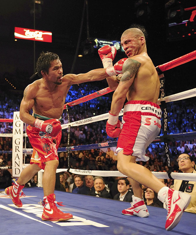 SI.com's Fighter of the Year became undisputed king of the 140-pounders on May 2 with a vicious second-round knockout of Ricky Hatton. With the victory, Pacquiao became the first boxer in history to win the lineal championship in four weight classes. The Filipino southpaw next moved up to welterweight on Nov. 14 and earned a piece of the 147-pound title with a 12th-round TKO of Miguel Cotto.