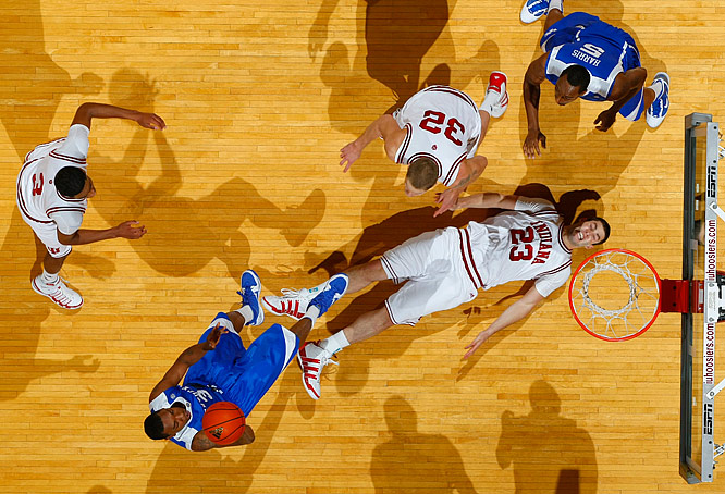 Darnell Dodson of Kentucky shoots over a prone Bobby Capobianco of unranked Indiana as the Wildcats won 90-73 on Dec. 12. The victory raised Kentucky's record to 10-0, the school's best start since 1992-93.