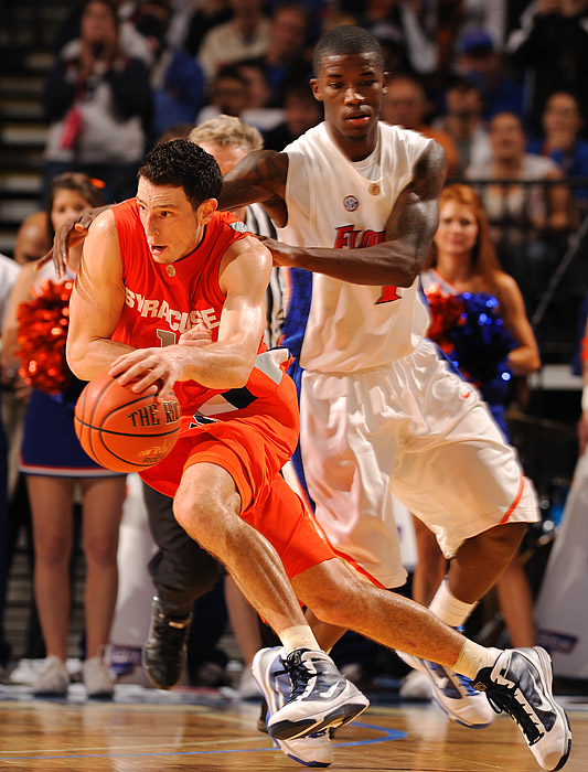 Andy Rautins of Syracuse drives past Kenny Boynton of Florida. Rautins finished with 18 points.