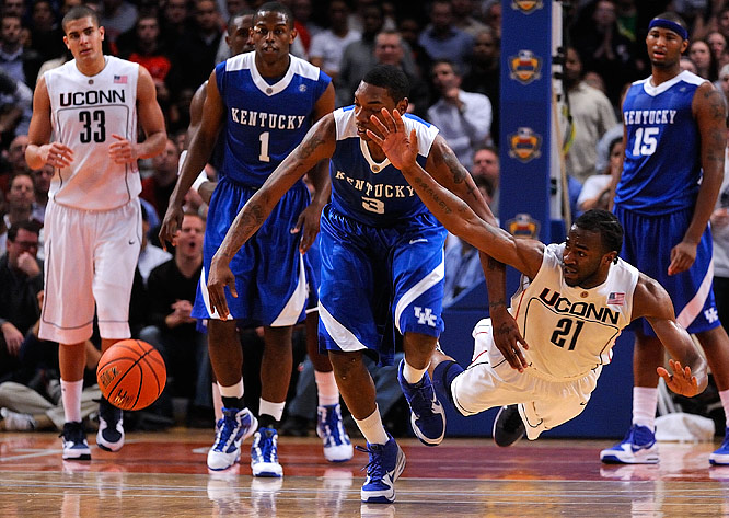 Kentucky's Darnell Dodson scrambles for a loose ball against UConn's Stanley Robinson.