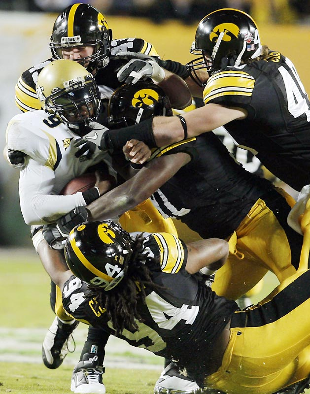 Iowa held Josh Nesbitt (left) and the Yellow Jackets' second-ranked rushing offense to 164 yards below its season average to give the Big Ten its second BCS win.