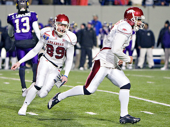 Alex Tejada (left) kicked the 37-yard OT winner, turned around and ran toward the opposite end of the field. His Arkansas teammates chased him all the way to the end zone amid a wild scene of celebration and relief.
