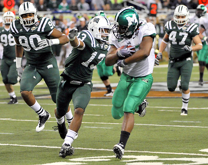 Martin Ward (left) ran for two touchdowns in the first half and Marshall held off a late Ohio rally. The Herd led by three touchdowns midway through the second quarter.