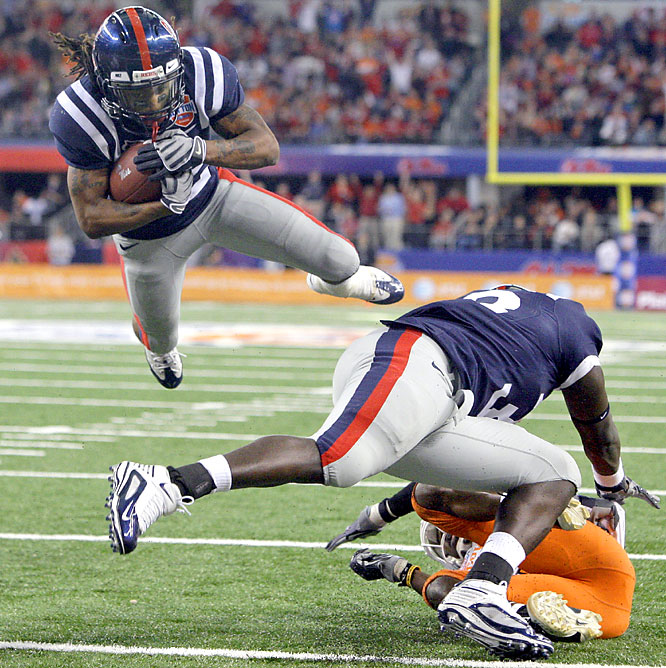 Dexter McCluster (left) gave Mississippi fans a finale to remember, rushing for 182 yards and two touchdowns, including the go-ahead 2-yard run on a direct snap with 4:03 left. Ole Miss had five turnovers in the game, but Oklahoma State had six in the fourth quarter, and seven overall.