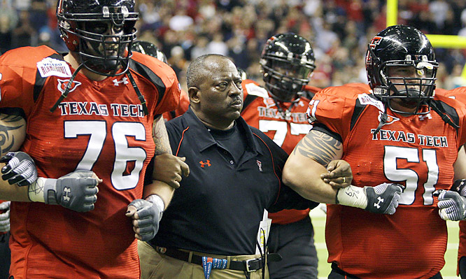 Ruffin McNeill (center) and Texas Tech closed out a difficult week with a game Mike Leach would've loved. The interim coach showed guts while pulling his starting QB and succeeding on two late fourth downs to help the Red Raiders beat the Spartans.
