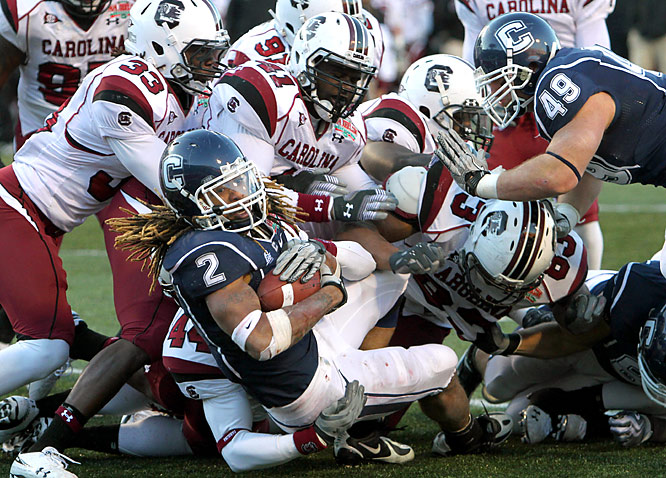 Andre Dixon (2) rushed for 126 yards and a touchdown and resilient Connecticut ended a trying season with a victory over South Carolina.
