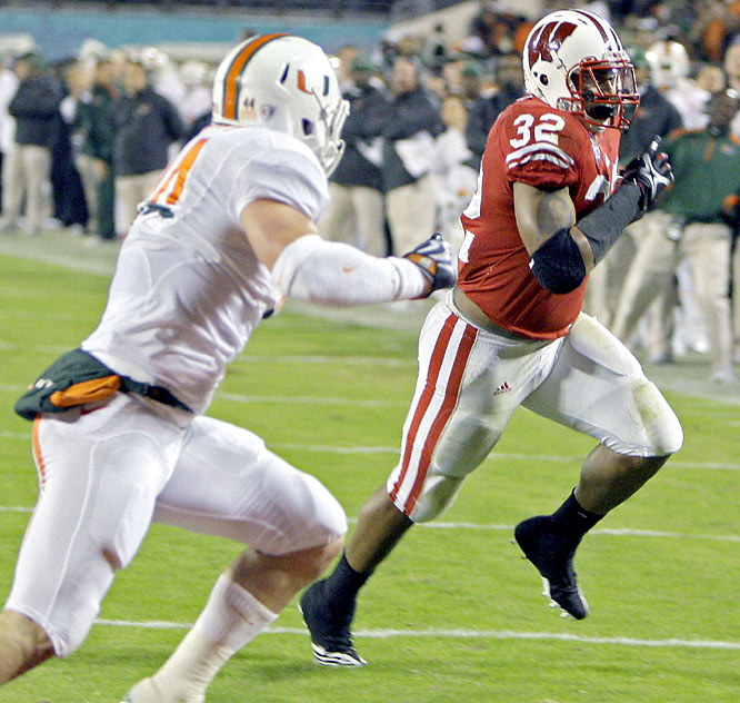 John Clay had 121 yards rushing and two touchdowns to power the Badgers past Miami. Wisconsin's defense recorded five sacks in the win.