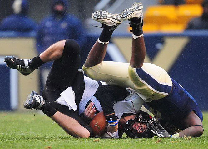 Quarterback Tony Pike is upended by Adam Gunn of Pittsburgh.