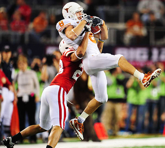 Wideout Jordan Shipley makes a catch as Eric Hagg defends.