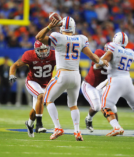 Linebacker Eryk Anders tries to get to Tim Tebow before he can pass.