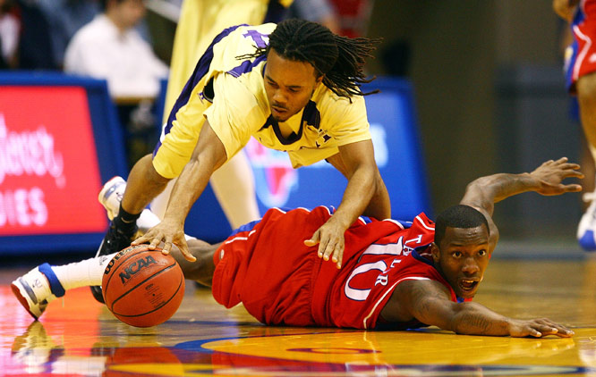 Derrick Blackwell of the Alcorn State Braves battles Tyshawn Taylor of the Kansas Jayhawks for a loose ball during their game on Dec. 2 at Allen Fieldhouse in Lawrence, Kansas. The No. 1-ranked Jayhawks trounced the Braves 98-31.