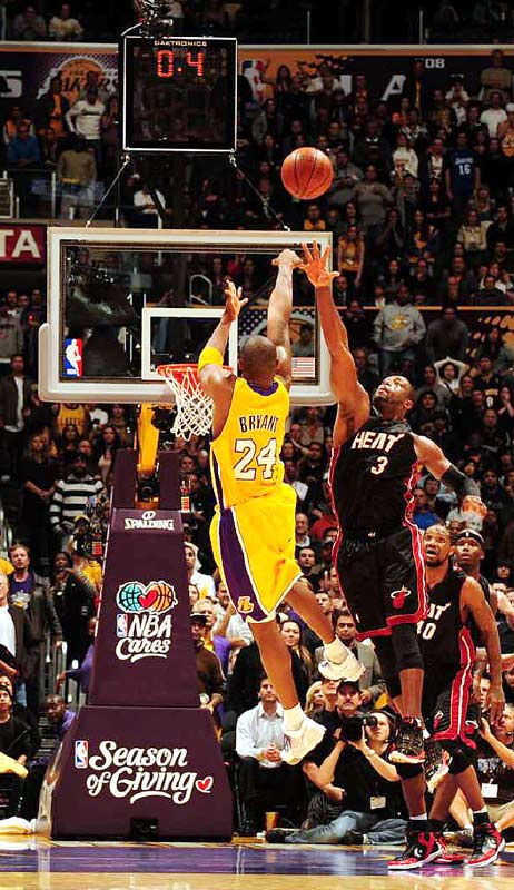 Lakers star Kobe Bryant shoots a last-second three pointer against Dwyane Wade of the Miami Heat to give Los Angeles a 108-107 win at L.A.'s Staples Center on Dec. 4.