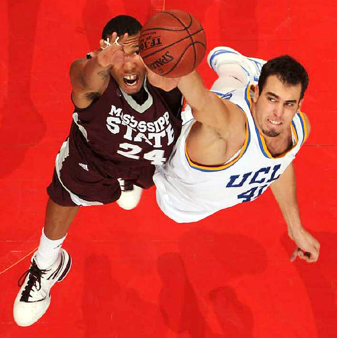 Forward Kodi Augustus of Mississippi State battles for a rebound with Nikola Dragovic of UCLA during the John Wooden Classic on Dec. 12 in Anaheim. Mississippi State won 72-54.