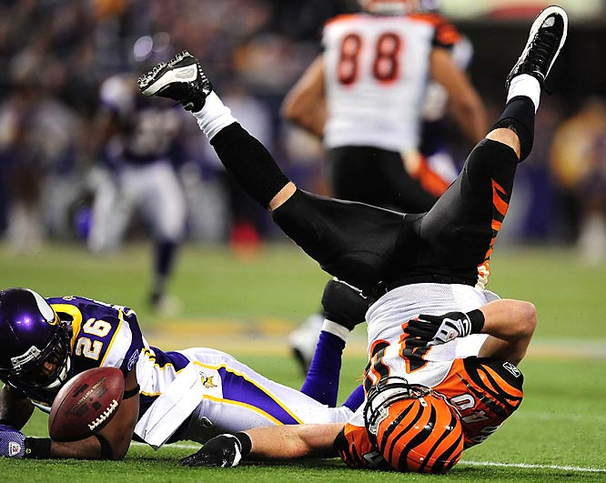 Cincinnati halfback Brian Leonard (40) is upended by Minnesota cornerback Antoine Winfield during their game at the Metrodome on Dec. 13. The Vikings defeated the Bengals 30-10.
