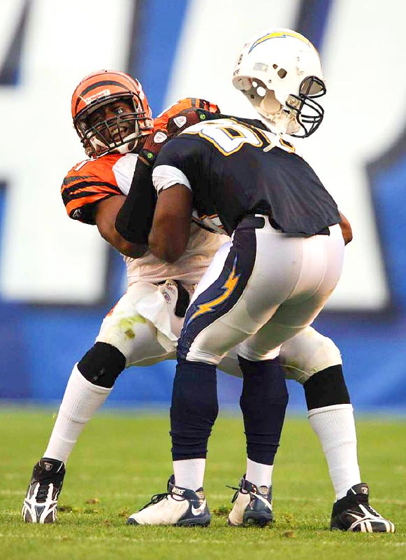 Chargers tight end Kris Wilson loses his helmet as he is tackled by Cincinnati Bengals safety Chinedum Ndukwe in the Chargers' 27-24 victory on Dec. 20 in San Diego.