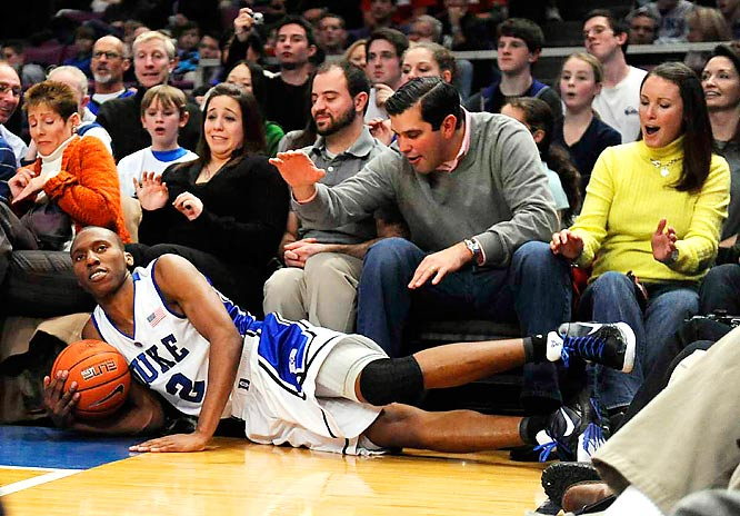 Duke guard  Nolan Smith slides into spectators while chasing a loose ball against the Gonzaga Bulldogs in the second half of the Aeropostale Classic at Madison Square Garden on Dec. 19. Smith led all scorers with 24 points as Duke defeated Gonzaga 76-41.