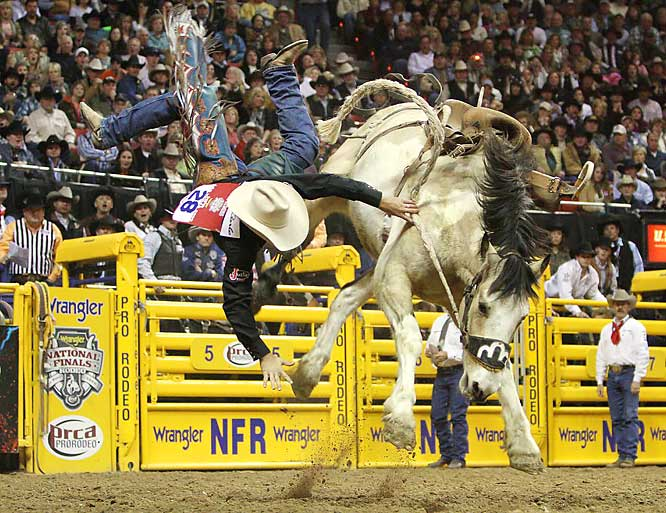 "Saddle bronc rider Heith DeMoss from Heflin, La., gets tossed by ""Pretty Boy"" during the 9th round at the National Finals Rodeo in Las Vegas on Dec. 11. DeMoss finished in 15th place."