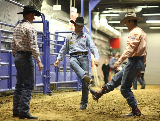 "SI photographer Darren Carroll went behind the scenes in Las Vegas recently with bareback rider Bobby Mote (center), who claimed his third world championship at the National Finals Rodeo. Mote, of Culver, Ore., had an event-record $310,219, which broke Will Lowe's single-season earnings record of $280,227 set in 2006. Mote had at least a share of first place in four of the last five rounds and won the aggregate race with 830 points on 10 rides. ""I've been here four times in the same situation in the 10th round when it was do or die, and I've done well a couple times and have messed up a couple times,"" Mote said. ""Having that experience sure enough helped, but it didn't make it any easier."""