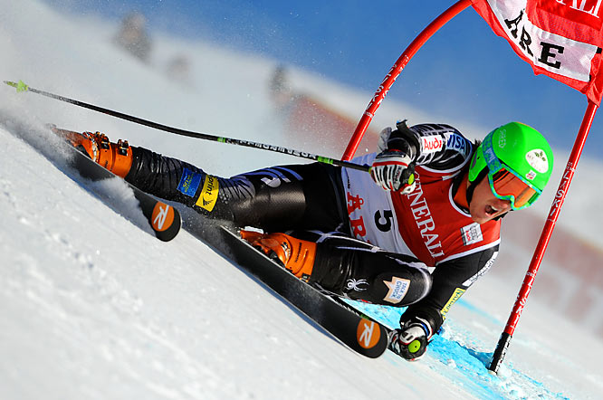 "After getting his first Olympic experience as a practice forerunner at the 2002 Salt Lake Games, Ligety became just like other skiers on the circuit, sporting his chief sponsor on his racing helmet, except in his case, the sponsors were the handwritten words ""mom"" and ""dad."" Though best known for his prowess in giant slalom, Ligety, who had never won a World Cup race by 2006, saved his first major international triumph for the Olympics in Turin, where he won the combined in a stunning upset."
