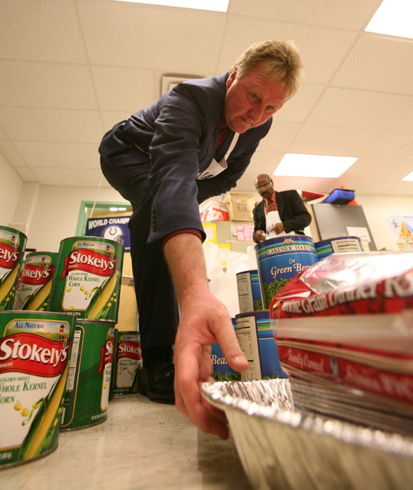 Bird helps gather food for needy families at the Indiana Pacers Academy.