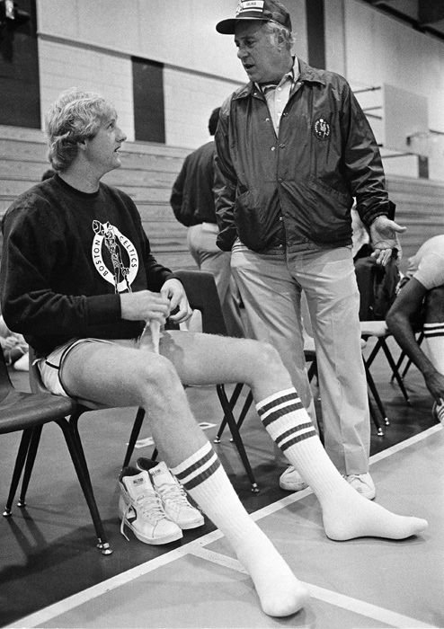 Bird talks with Celtics general manager Red Auerbach before the start of his rookie camp. He would win Rookie of the Year honors after averaging 21.3 points and 10.4 rebounds per game.