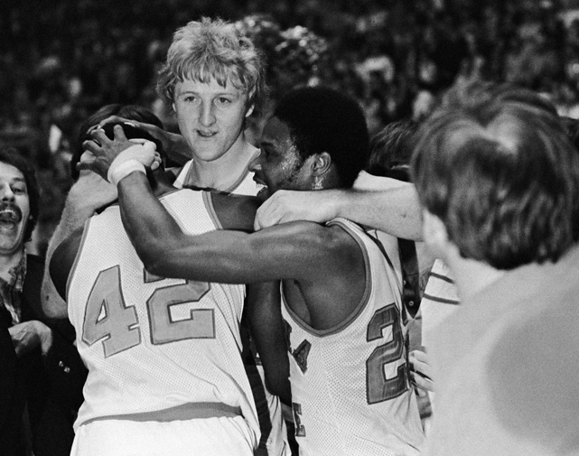 Bird hugs teammates Alex Gilbert (left) and Carl Nicks after Indiana State beat Arkansas 73-71 to advance to the Final Four.