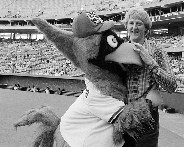 The college basketball player of the year gets a hug from the St. Louis Cardinals mascot before a June game at Busch Stadium. Bird threw out the first pitch.