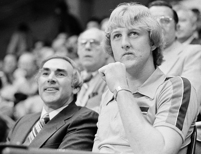 Less than two weeks after his Indiana State team fell to Michigan State in the national championship game, Bird takes in a Celtics game with his agent, Wolf.