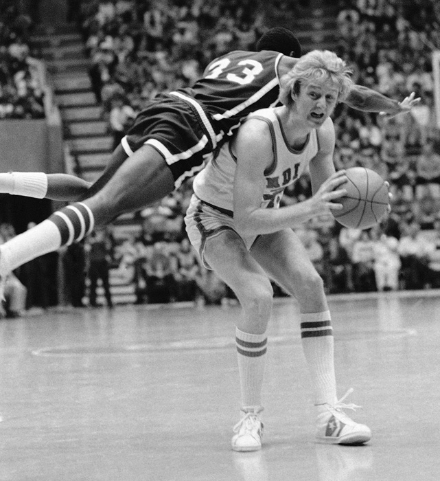 The All-American draws a foul from West Texas State's Erskine Robinson during the Missouri Valley Conference tournament.