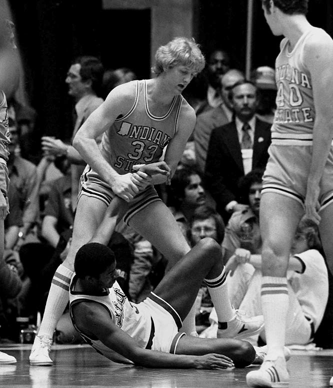 Bird gives Johnson a helping hand during the NCAA Championship game in Salt Lake City.