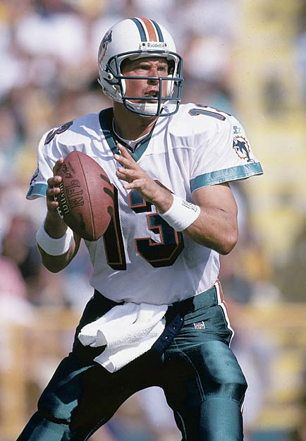 Miami's Dan Marino sets NFL season records for touchdowns (48), completions (362) and yards (5084).