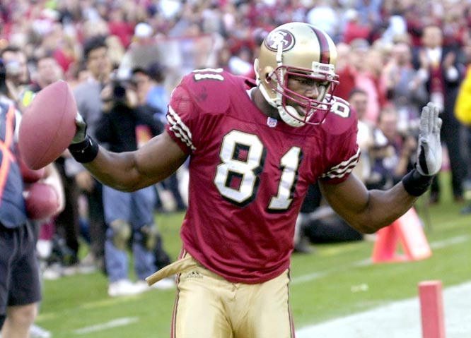 San Francisco's Terrell Owens catches an NFL-record 20 passes for 283 yards and a touchdown against the Chicago Bears.