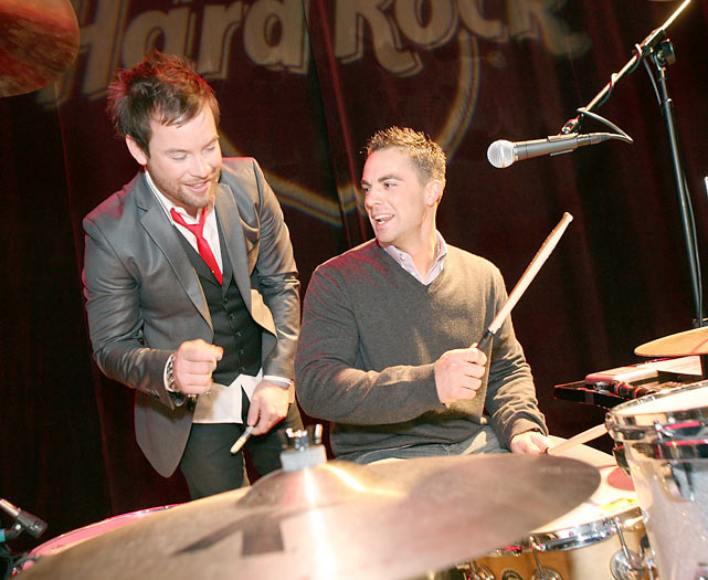 Seventh season winner David Cook shows Mets third baseman David Wright how to hit the drums during the 4th Annual 'Do The Wright Thing' gala in New York City.