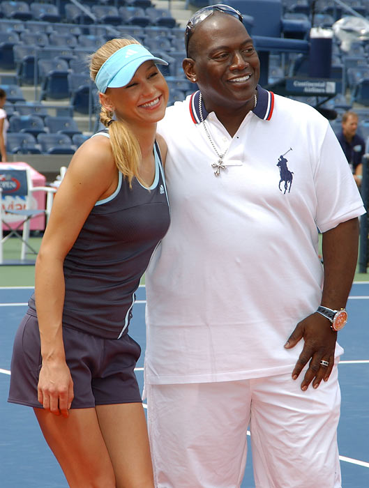 Anna Kournikova and Idol judge Randy Jackson pose on Arthur Ashe Kids Day before the start of the 2005 U.S. Open.