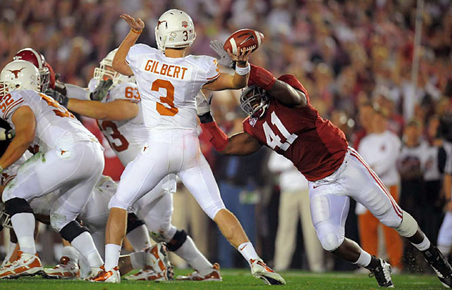 Texas survived a scare when Gilbert appeared to hurt his arm while attempting a pass.