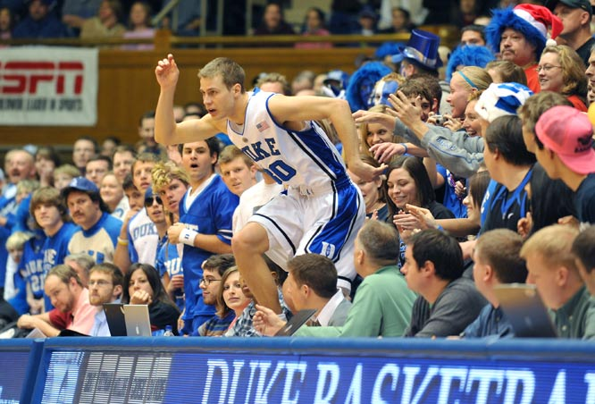 Duke guard Jon Scheyer leaps back onto the court during a game against the Pennsylvania Quakers at Cameron Indoor Stadium in Durham on Dec. 31. Duke won 114-55.