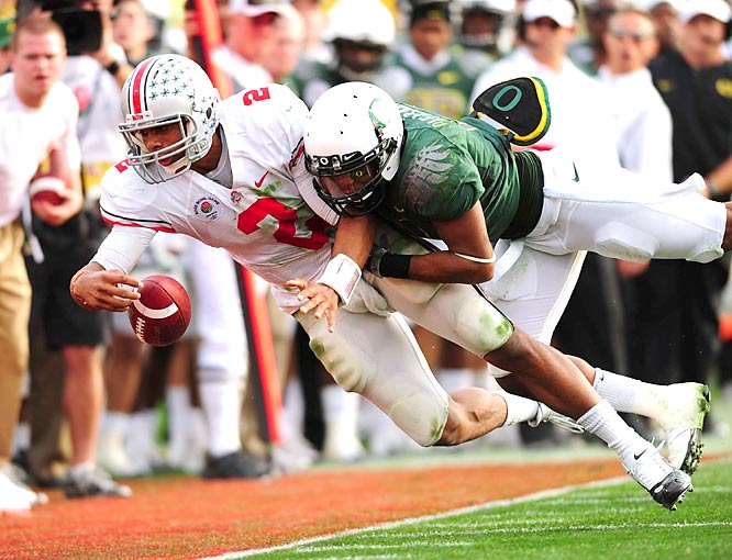Ohio State quarterback Terrelle Pryor is tackled by Oregon linebacker Eddie Pleasant at the 96th Rose Bowl in Pasadena on New Year's Day. Ohio State defeated Oregon 26-17.