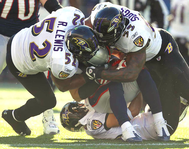 Baltimore Ravens defenders Ray Lewis, Terrell Suggs and Chris Carr gang tackle New England Patriots wide receiver Julian Edelman during their AFC wild-card matchup Jan. 10. The Ravens won 33-14.