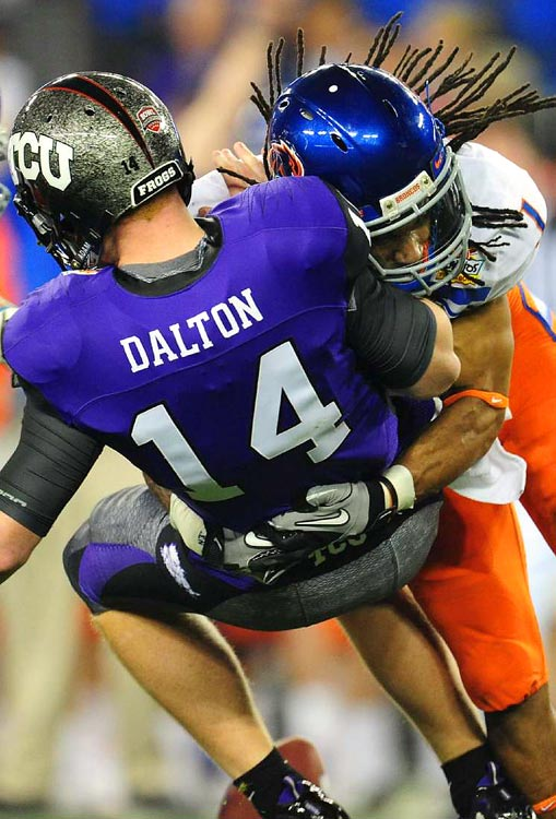 TCU quarterback Andy Dalton is sacked by Boise State cornerback Kyle Wilson during the first quarter of the Fiesta Bowl on Jan. 4, in Glendale, Ariz. Boise State defeated TCU 17-10. <br><br>Send comments to siwriters@simail.com.