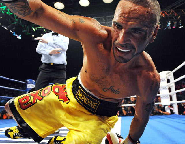 Australian champion Anthony Mundine is knocked down by compatriot Rob Medley during their World Boxing Association middleweight regional title bout in Sydney on Jan. 11. Mundine, 34, who has never lost to another Australian, got up and won the fight by unanimous decision.