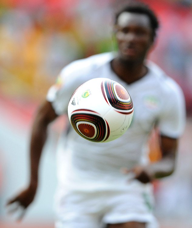 Moumouni Dagano of Burkina Faso runs after a ball during their African Cup of Nations qualifying match against Ghana at the November 11 stadium in Luanda, Angola, on Jan. 19. Ghana won 1-0.