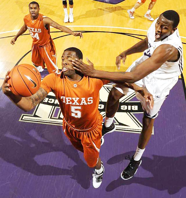 Texas guard Damion James gets smacked by Kansas State forward Curtis Kelly during the Wildcats' 71-62 upset win over the top-ranked Longhorns at Bramlage Coliseum in Manhattan, Kans., on Jan. 18.